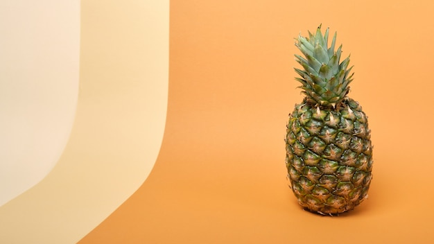 Fresh ripe tasty pineapple on a brown and beige background copy space