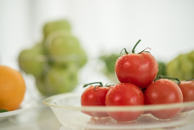 Fresh ripe tomatoes on table