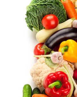 Fresh ripe vegetables on white surface