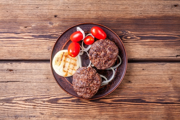 Fresh roasted burger meat with vegetables