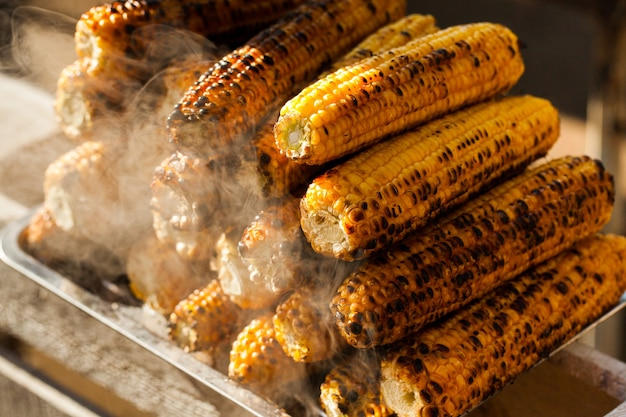 Fresh roasted or grilled corncobs with steam