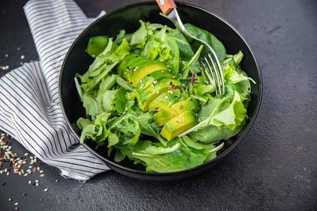 Fresh salad avocado leaf mix lettuce spinach arugula chard lettuce meal snack on the table