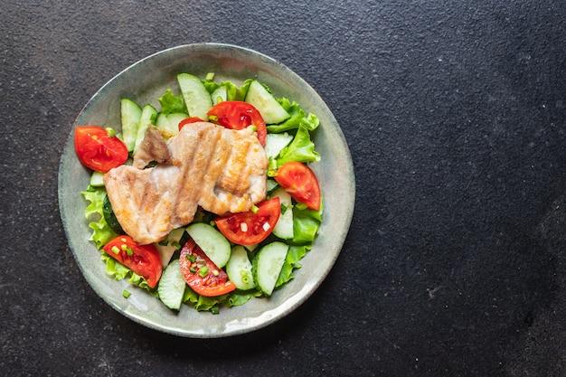 Fresh salad chicken breast vegetables tomato cucumber lettuce diet food vitamin meal snack