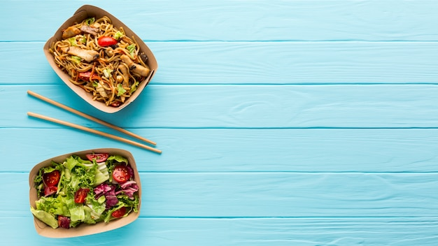 Fresh salad and chinese dish with copy space