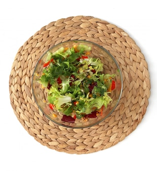 Fresh salad in a glass bowl on the stand