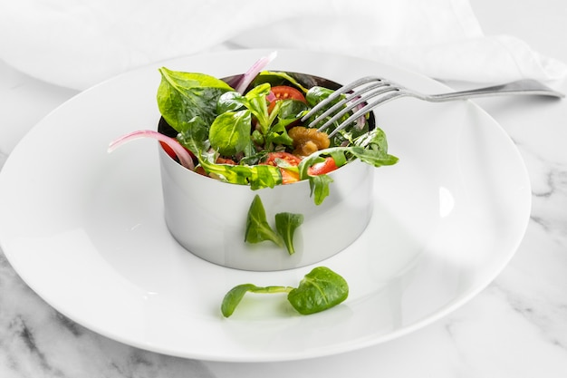 Fresh salad on white plate