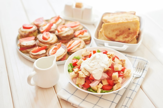 Fresh salad with cheese and ham
