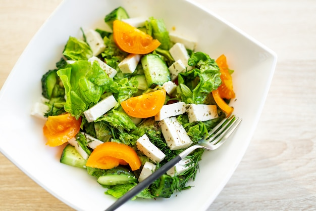 Fresh salad with cheese and tomatoes