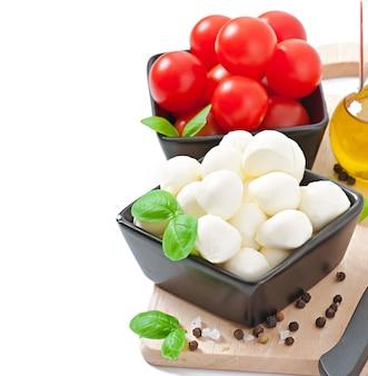 Fresh salad with cherry tomatoes, basil, mozzarella and black olives.