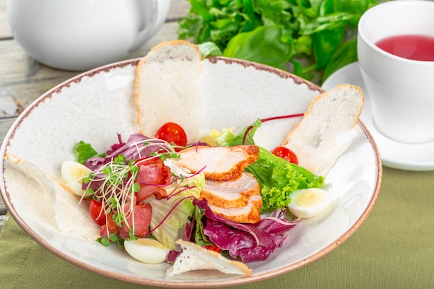 Fresh salad with chicken breast and tomato