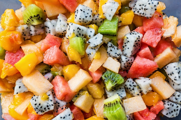 Fresh salad with exotic fruits closeup