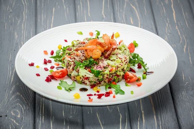 Fresh salad with vegetables, sprouted grains and shrimp