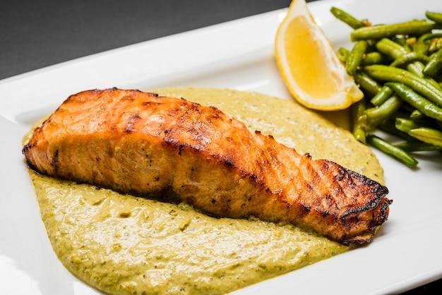 Fresh salmon dish on sauce