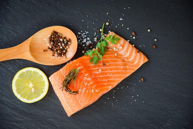 Fresh salmon fillet on dark background
