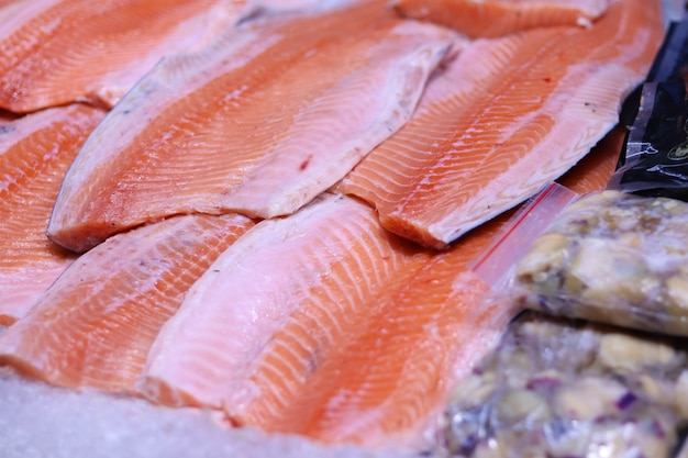 Fresh salmon fillet on ice, salmon on the counter in the store