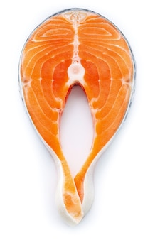 Fresh salmon fillet sliced isolated on white background