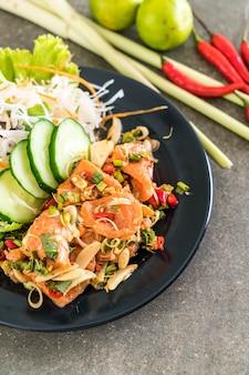 Fresh salmon raw spicy salad