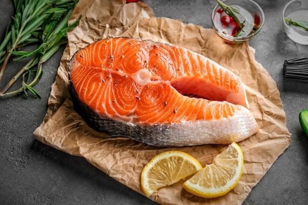 Fresh salmon steak on parchment paper