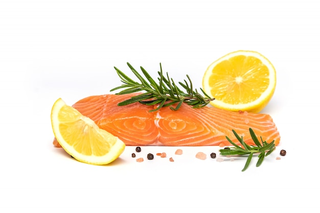 Fresh salmon steak with herbs and lemon isolated