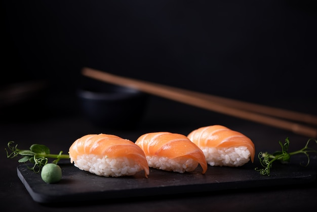 Fresh salmon sushi on blackboard