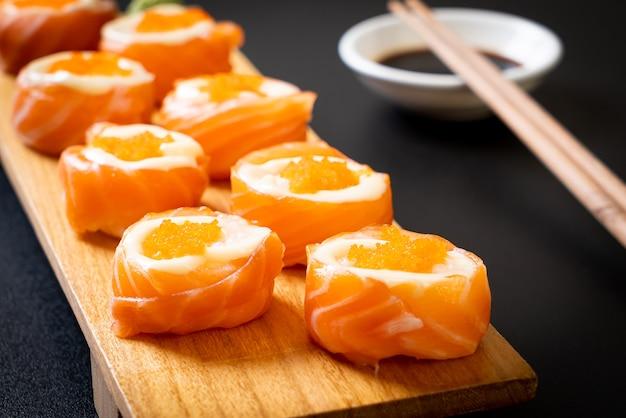 Fresh salmon sushi roll with mayonnaise and shrimp egg. japanese food style