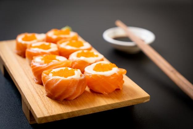 Fresh salmon sushi roll with mayonnaise and shrimp egg