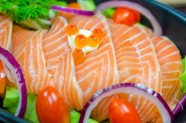 Fresh salmon sushi and tomato japanese food