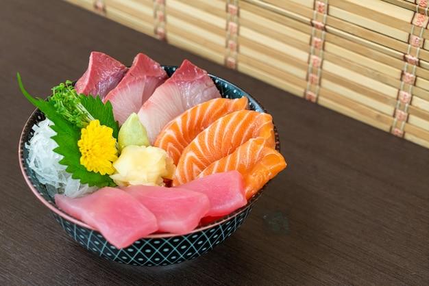 Fresh salmon, tuna and hamachi on topped rice bowl (donburi)