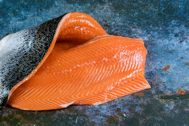 Fresh salmon with fillet on board
