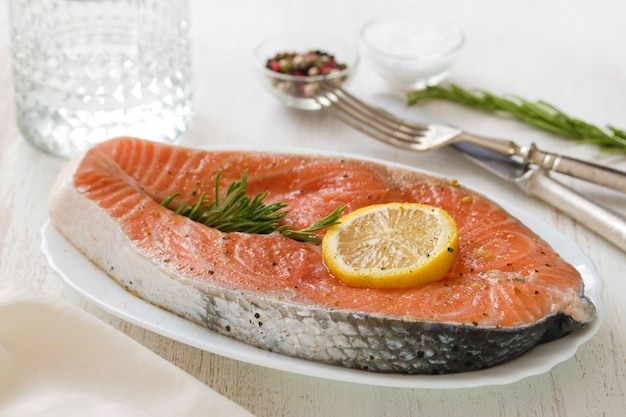 Fresh salmon with lemon on dish