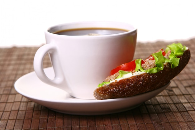 Fresh sandwich with fresh vegetables and coffee