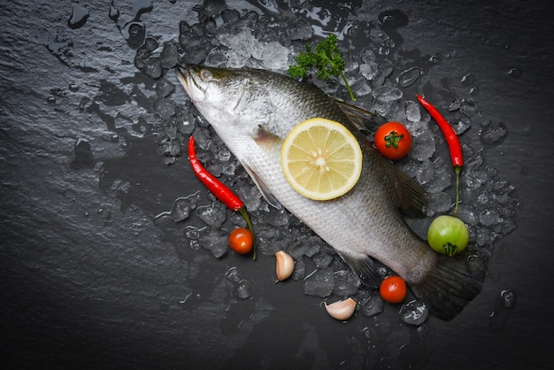 Fresh sea bass fish for cooking with herbs and spices