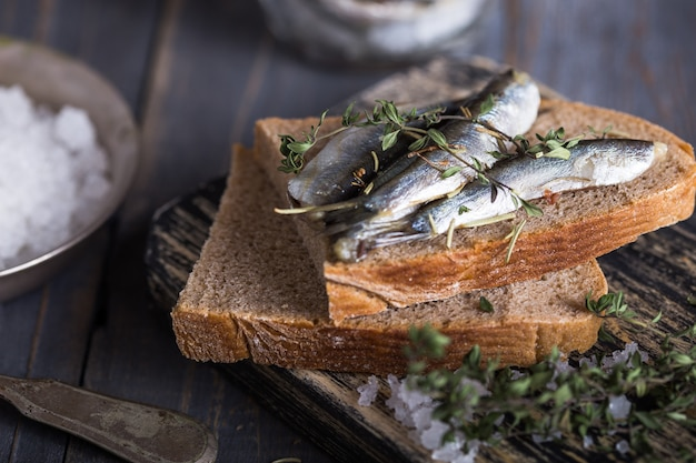 Fresh sea cold-water small fish such as smelt, sardine, anchovies on a simple background