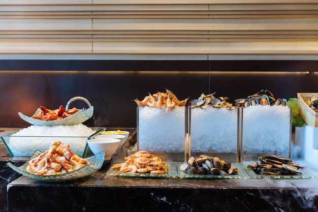 Fresh seafood buffet line including alaska king crab, shrimp, lobster, oyster