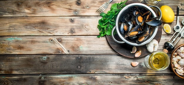 Fresh seafood clams in a pot of white wine. on a wooden background.