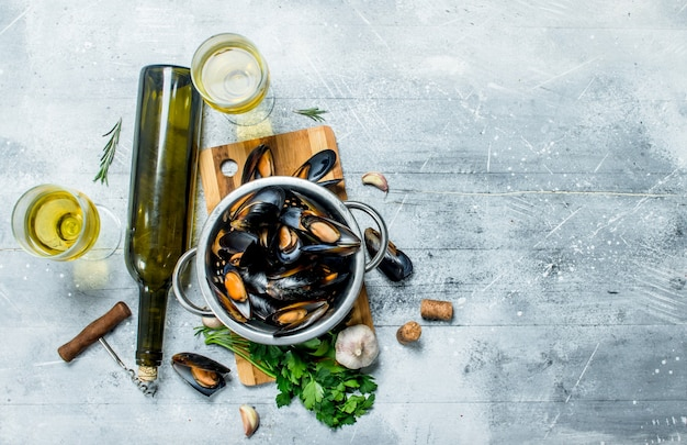 Fresh seafood clams with parsley and white wine. on a rustic table.