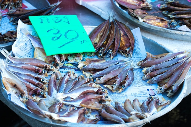 Fresh seafood on the counter at the fish market by the ocean.