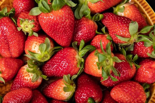 Fresh seasonal strawberries. juicy and sweet strawberries