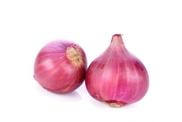 Fresh shallots isolated on white wall