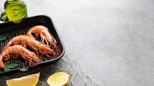 Fresh shrimps in pan with condiments