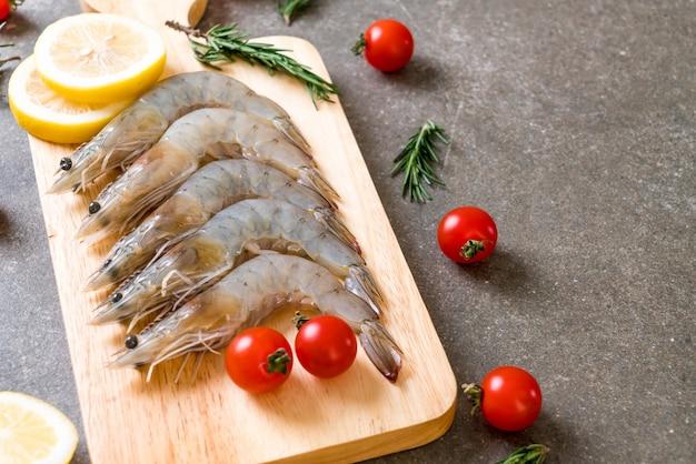 Fresh shrimps or prawns raw on wooden board