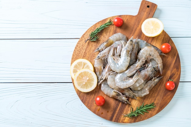 Fresh shrimps or prawns raw on wooden board