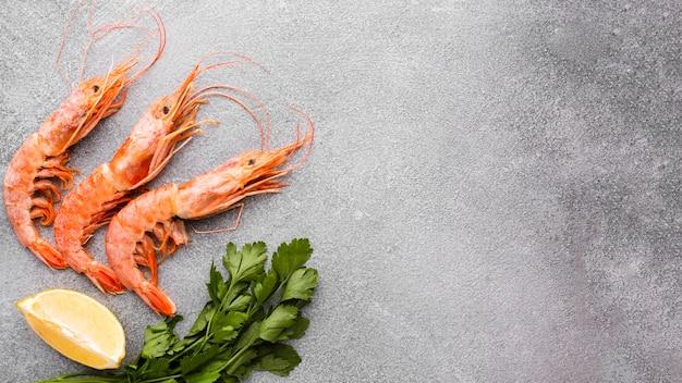 Fresh shrimps with lemon on table
