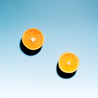 Fresh sliced orange on light background