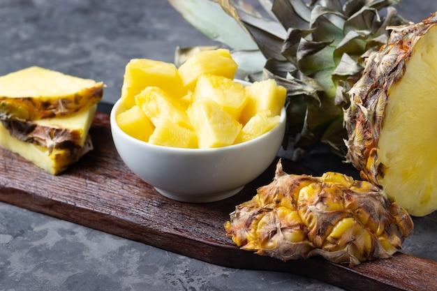 Fresh sliced pineapple on table