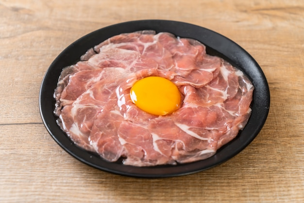 Fresh sliced pork raw with egg