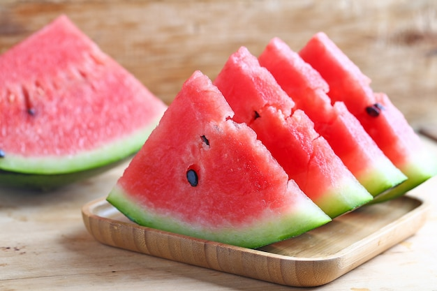 Fresh sliced watermelon on wooden background