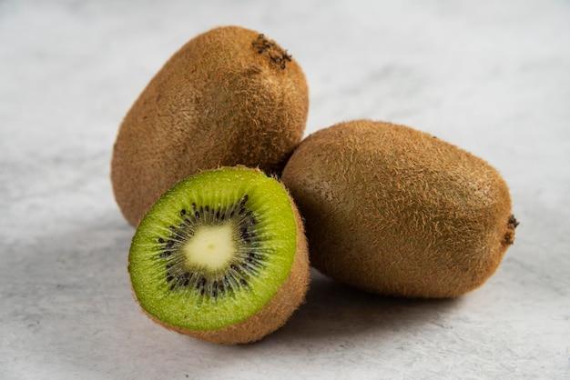 Fresh slices of kiwi on white.