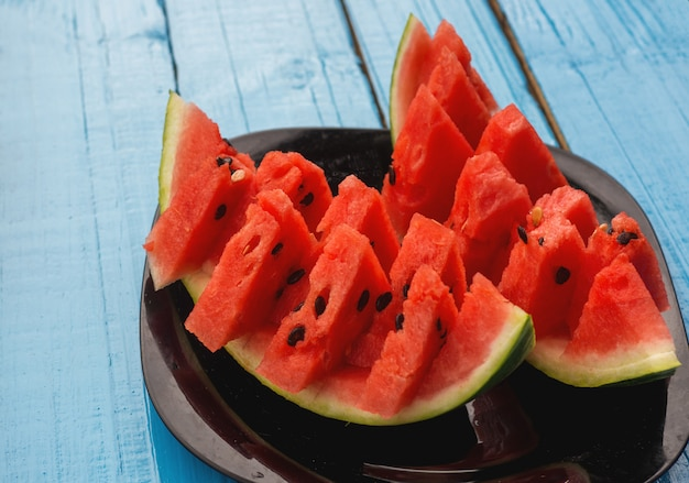 Fresh slices of watermelon on a blue background