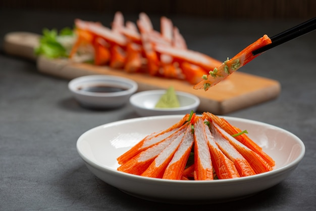Fresh slides of crab sticks with wasabi and soy sauce